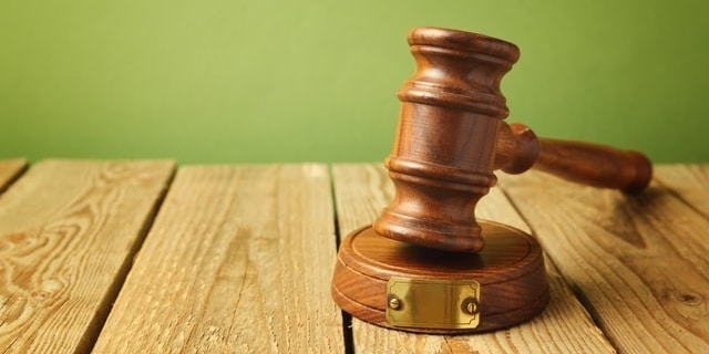 Gavel sitting on wooden table